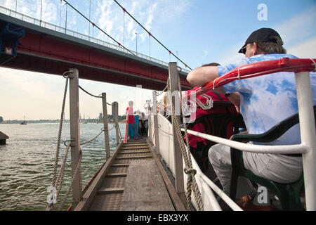 people during a harbour sightseeing-tour on Rhine river, Friedrich Ebert bridge in the background, Germany, North - Stock Photo