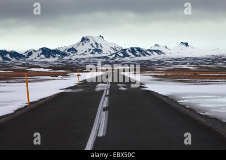 highland road Kjalvegur in winter sraightly leading to the glacier Langjoekull, Iceland, Suedwest Island - Stock Photo