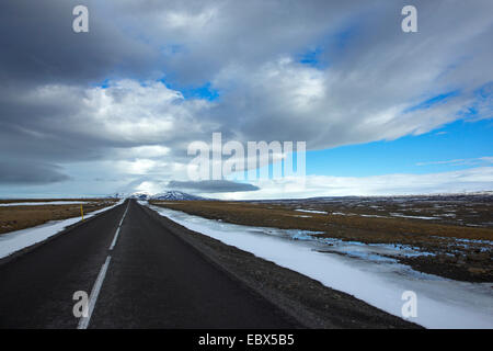 highland road Kjalvegur in winter leading to the horizon in perfect straightness, Iceland, Suedwest Island - Stock Photo