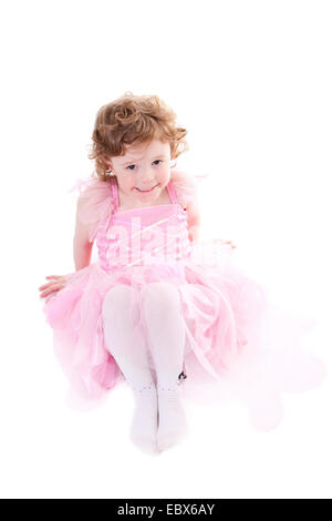 Cute curly haired girl in little fairy dress - Stock Photo