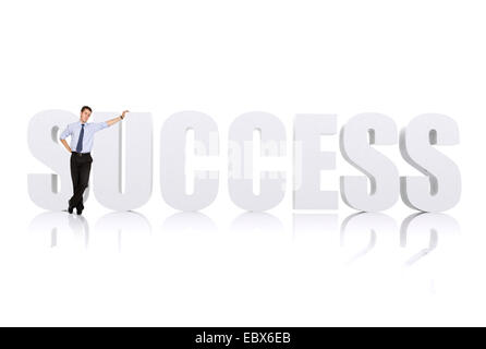 business man leaning on the word success over white - Stock Photo