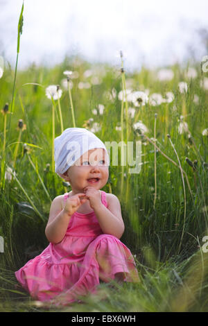 baby girl outdoors at sunny summer day - Stock Photo