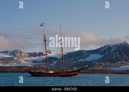 two-masted sailing ship in a fjord, Norway, Svalbard, Kongsfjorden - Stock Photo