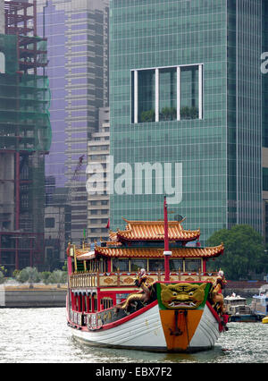 junk in front of skyscrapers, Singapore - Stock Photo