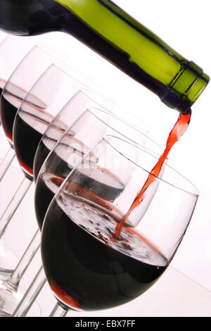 red wine pouring in glasses - Stock Photo