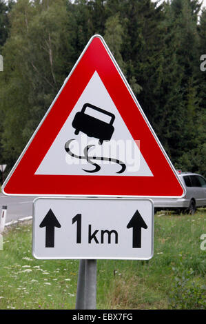 traffic sign, slippery road - Stock Photo