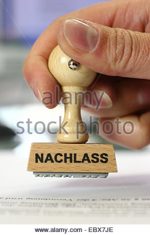 hand with a stamp Nachlass, deduction - Stock Photo