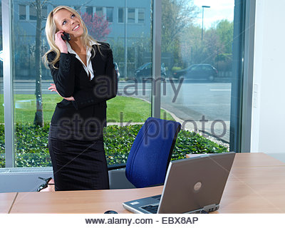 business lady telephoning in her office - Stock Photo
