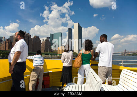 People admiring the view of DOWNTOWN MANHATTAN aboard the NEW YORK WATER TAXI, USA, New York City - Stock Photo
