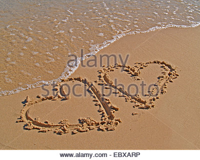 hearts painted in the sand - Stock Photo