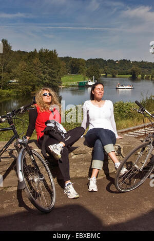 two bicyclists having a break at Hardenstein Castle ruin, Germany, North Rhine-Westphalia, Ruhr Area, Witten - Stock Photo