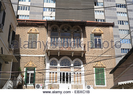 old house in front of modern high-rise building, Lebanon, Beirut - Stock Photo