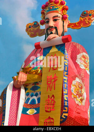 huge Chinese statue for New Years Celebrations, Singapore - Stock Photo