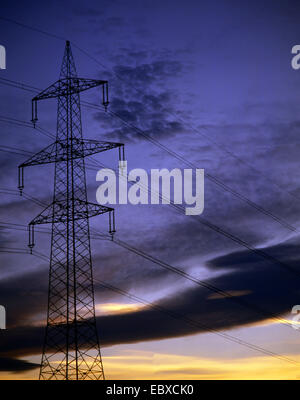 power pole in front of evening sky - Stock Photo