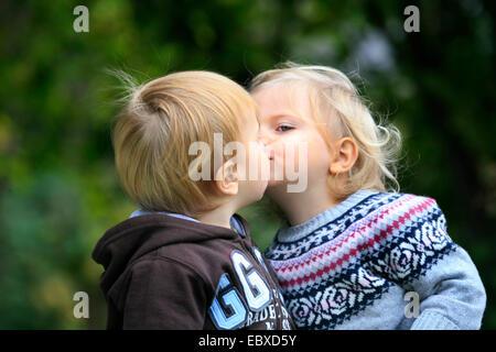 little boy and little girl, kissing - Stock Photo