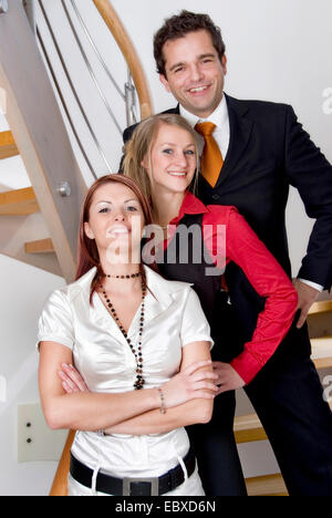 three young people using mobile - Stock Photo