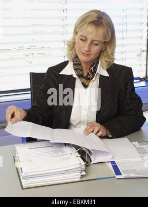 woman working in office - Stock Photo