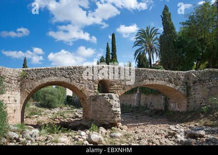 Old Roman double arch stone bridge Pollenca Mallorca Spain - Stock Photo