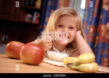 child, girl reading a book - Stock Photo