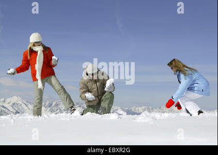 young people having snowball fight, fun - Stock Photo