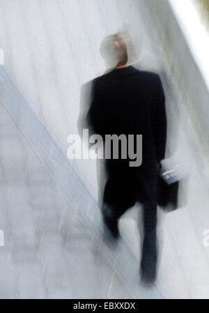 man walking, moving fuzziness - Stock Photo