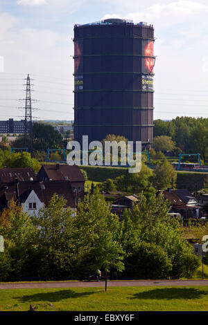 view from Olga Park to Gasometer Oberhausen, Germany, North Rhine-Westphalia, Ruhr Area, Oberhausen - Stock Photo