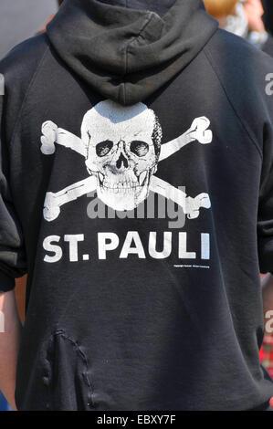 St Pauli fan with typical skull logo on hoody, Germany, Baden-Wuerttemberg