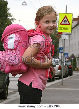 Little girl goes to school - Stock Photo