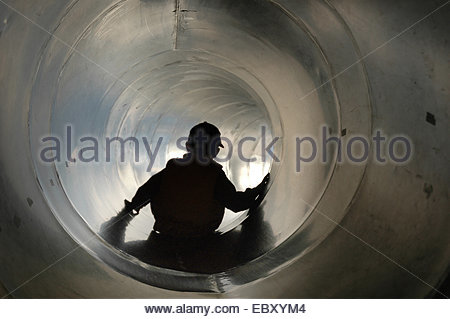symbolpicture fear, little boy in a lide - Stock Photo