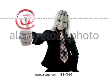 Woman in black suit pressing a virtual internet symbol - Stock Photo