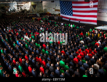 Chief of Naval Operations Adm. Jonathan Greenert address an all hands call in the hanger bay aboard the nuclear - Stock Photo