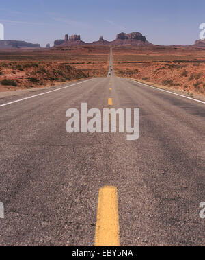 Road leading to Monument Valley Utah USA - Stock Photo