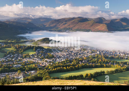 Keswick and mist covered Derwent Water at dawn, Lake District, Cumbria, England. Autumn (October) 2012. - Stock Photo