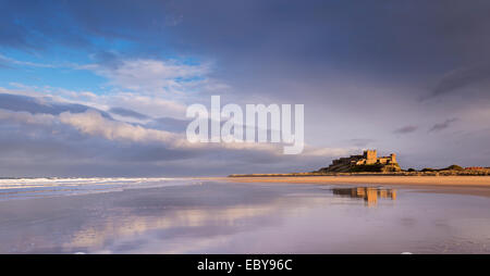 Bamburgh Castle and beautiful deserted beach, Northumberland, England. Winter (March) 2014. - Stock Photo