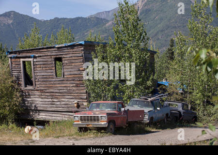 Old cars parked in front of an old building in McCarthy, Alaska, USA - Stock Photo