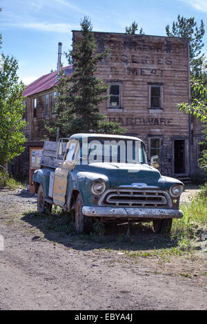 An old car parked in front of an old building in McCarthy, Alaska, USA - Stock Photo