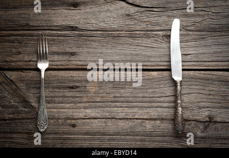 knife and fork on wooden background. - Stock Photo