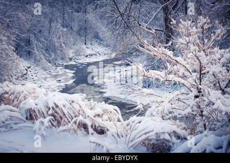 Winter landscape of snow covered forest with icy river after snowfall. Ontario, Canada. - Stock Photo