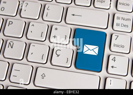Spanish keyboard with email concept mail envelope icon over