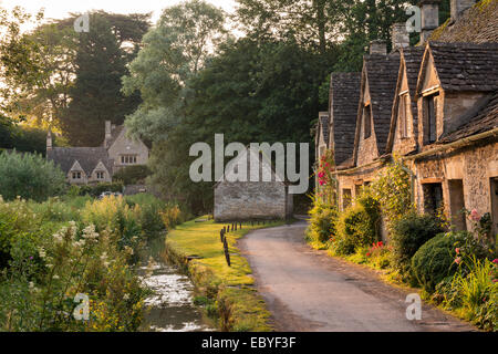 Picturesque cottages at Arlington Row in the Cotswolds village of Bibury, Gloucestershire, England. Summer (July) - Stock Photo