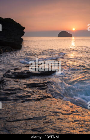 Sunset over Trebarwith Strand beach in North Cornwall, England. Autumn (September) 2014. - Stock Photo