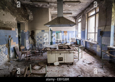 Kitchen in hospital in Pripyat abandoned city, Chernobyl Exclusion Zone, Ukraine - Stock Photo