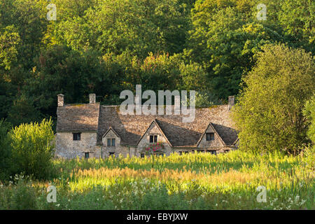 Arlington Row cottages in the Cotswold village of Bibury, Gloucestershire, England. Summer (July) 2014. - Stock Photo