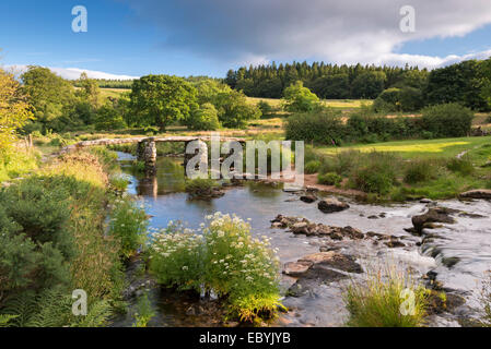 Ancient clapper bridge at Postbridge, Dartmoor National Park, Devon, England. Summer (July) 2014. - Stock Photo