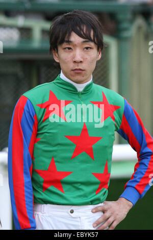 Kyoto, Japan. 30th Nov, 2014. Ken Tanaka Horse Racing : Jockey Ken Tanaka after riding Am Ball Bleiben to win the - Stock Photo