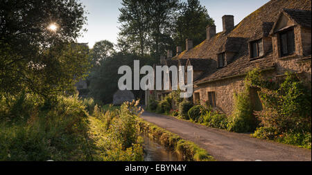 Pretty cottages at Arlington Row in the Cotswolds village of Bibury, Gloucestershire, England. Summer (July) 2014. - Stock Photo