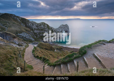 Winding coastpath steps leading down to Durdle Door on the Jurassic Coast, Dorset, England. Autumn (November) 2014. - Stock Photo