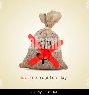 a burlap money bag with two diagonal red slashes for the anti-corruption day - Stock Photo