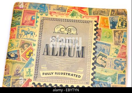 An old fully illustrated stamp album cover english language - Stock Photo