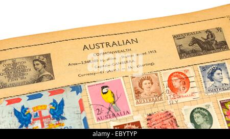 An old fully illustrated stamp album with stamps from Australia - Stock Photo